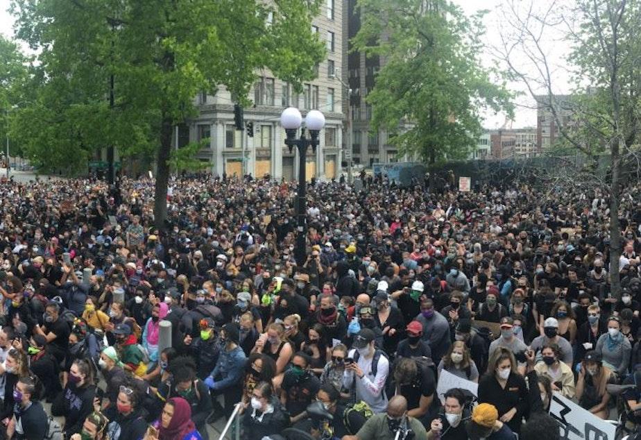 caption: Demonstrators march on Seattle City Hall, June 3, 2020.