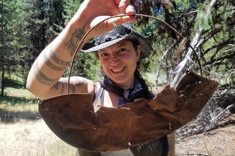 Southern Oregon University archaeologist Chelsea Rose with remnants of a five-part gold pan found during a dig this summer.CREDIT SOUTHERN OREGON UNIV. LABORATORY OF ANTHROPOLOGY