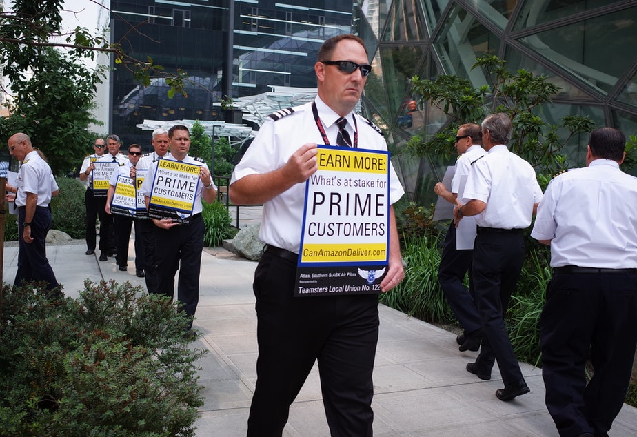 FILE: Pilots who work at contractors who fly cargo for Amazon protested on the sidewalk below The Spheres.