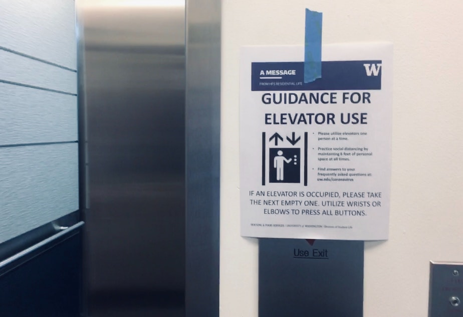 caption: Students and families are advised to take the elevator one at a time at Mercer Court at UW Seattle Campus. March 19, 2020.