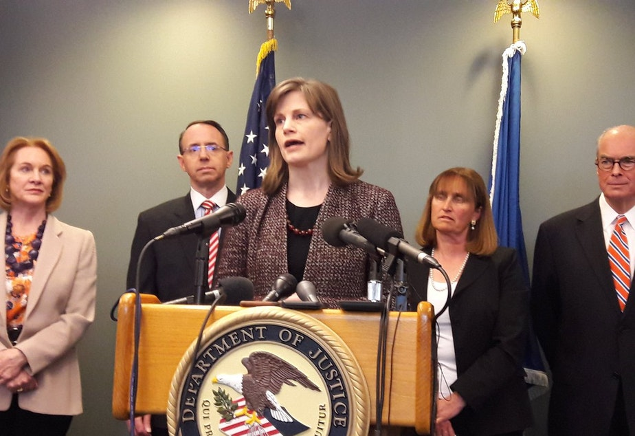 Amy Wales, daughter of Thomas Wales speaks at a news conference on February 21, 2018 in Seattle. At left is Mayor Jenny Durkan, and deputy U.S. Attorney General Rod Rosenstein. Rosenstein was in Seattle to give an update on the Wales case.