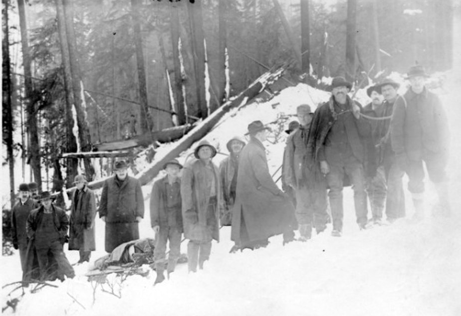 caption: This photo was taken in the immediate aftermath of the Wellington Avalanche in 1910.