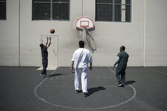 FILE: Detainees play basketball at the Northwest Detention Center in Tacoma