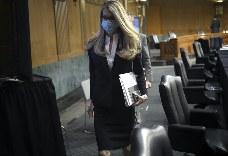caption: Sen. Kelly Loeffler, R-Ga., leaves after a virtual Senate Committee for Health, Education, Labor, and Pensions hearing on May 12.