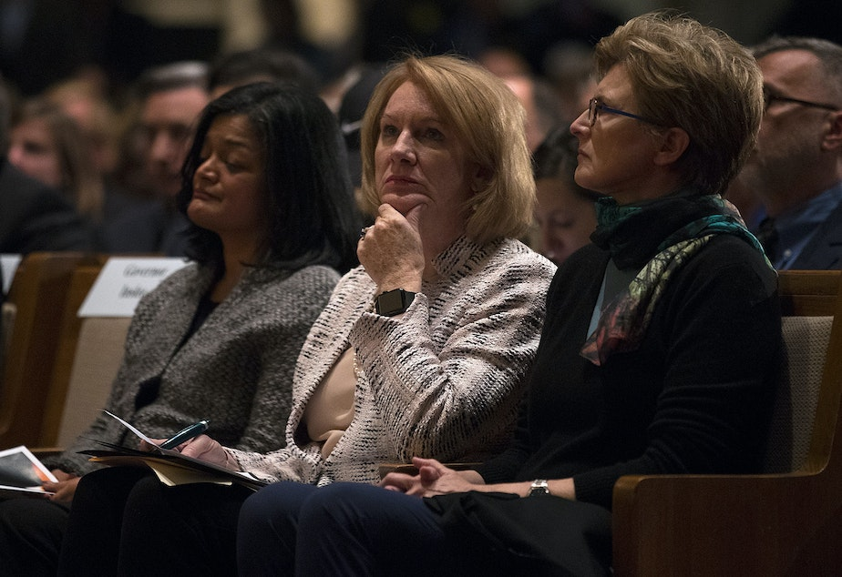 caption: Seattle mayor Jenny Durkan listens during a community vigil for Pittsburgh on Monday, October 29, 2018, at the Temple De Hirsch Sinai on 16th Avenue in Seattle.