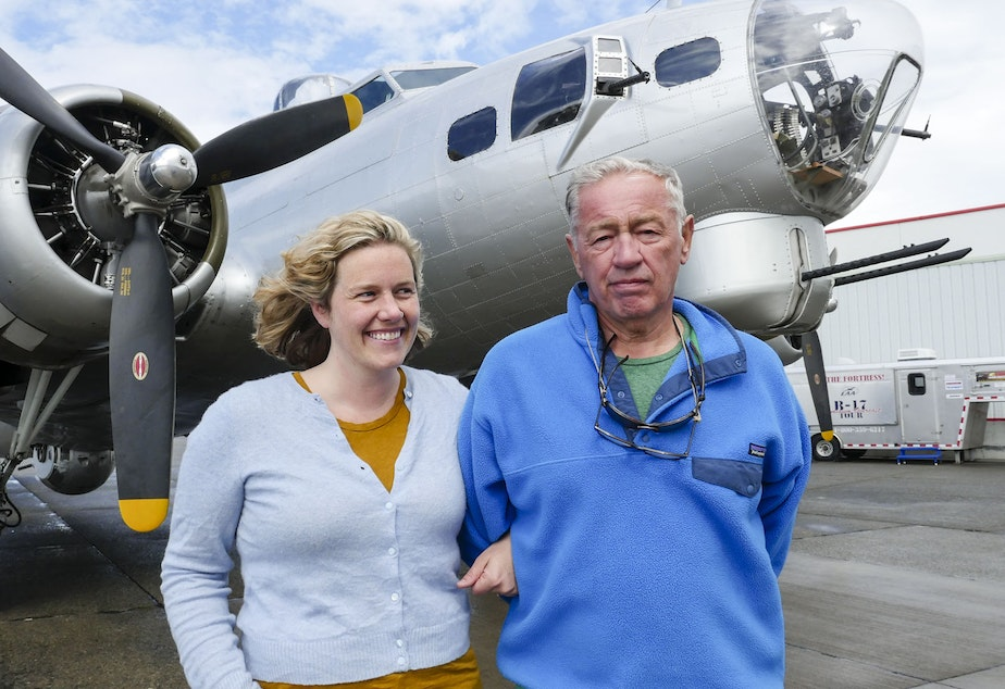 caption: Reporter Ashley Ahearn with her father Joe Ahearn Jr. Ahearn researched the history of the Boeing B-17 bomber, said to have won the war. Boeing recruited workers from around the country to build the bomber -- many were women, and many were black.