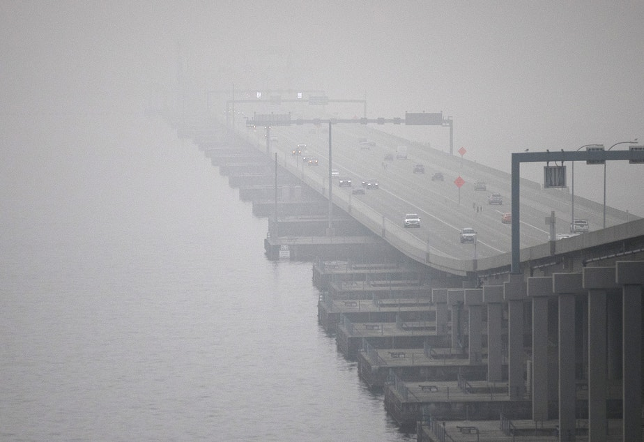 caption: The SR 520 bridge disappears from view as smoke from wildfires burning in California and Oregon continues to blanket the area, on Monday, September 14, 2020, in Seattle. The air quality in the region has fluctuated between unhealthy, very unhealthy and hazardous.