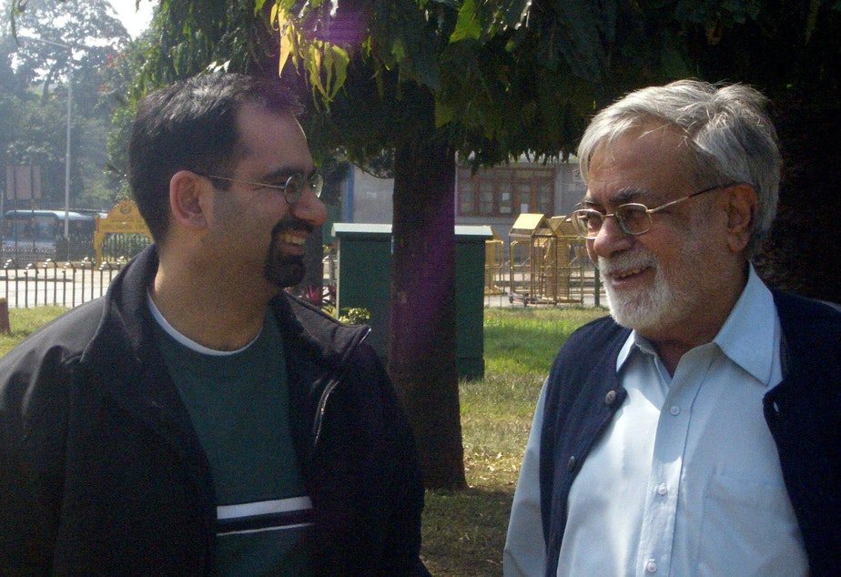 caption: Agastya and Narendra Kohli in 2010