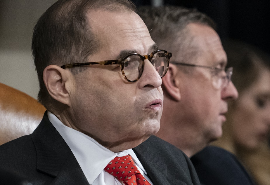 "caption: House Judiciary Committee Chairman Jerry Nadler had adjourned Thursday without a vote on the articles of impeachment. Ranking member Doug Collins (in background) likened the move to a ""kangaroo court."""