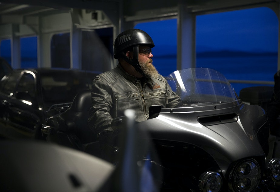 Tim Radebaugh sits on his motorcycle while waiting to exit the ferry at Fauntleroy ferry terminal at 4:46 a.m. on Wednesday, June 12, 2019. He is one of the ferry friends above.
