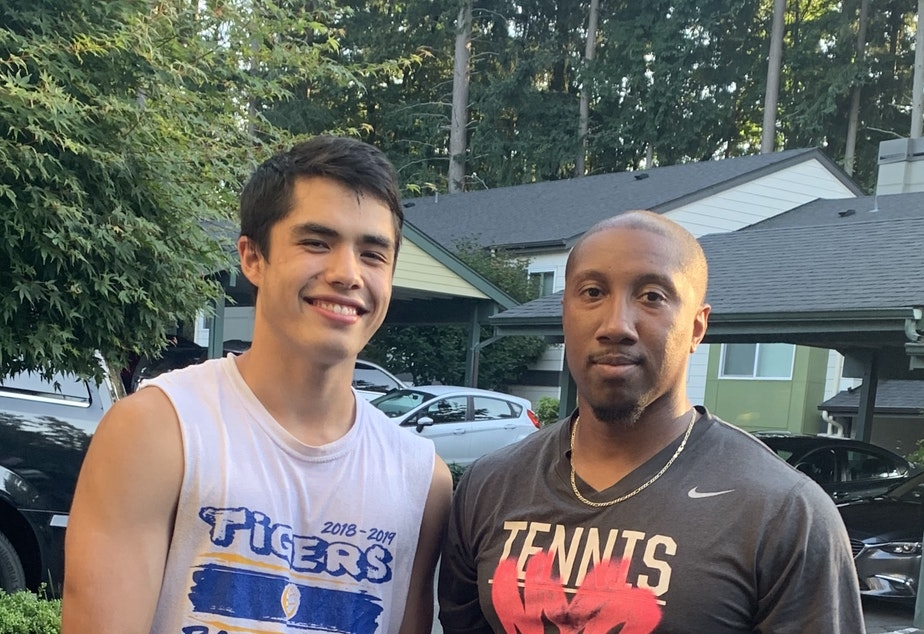 caption: Gabe Rambayon with his teacher and basketball coach, Jeffrey Forbes Jr.