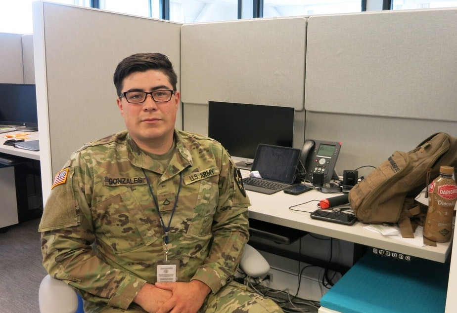 caption: Washington National Guard Pfc. Dominic Gonzales worked as a contact tracer at the state Department of Health in Tumwater in May.