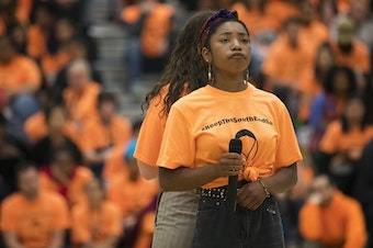 Savannah Blackwell, right, and Annabelle Russell, Franklin High School freshmen, perform a song during an assembly remembering slain classmate Ryan Dela Cruz.