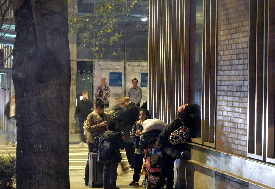 caption: Homeless families outside a shelter in downtown Seattle.