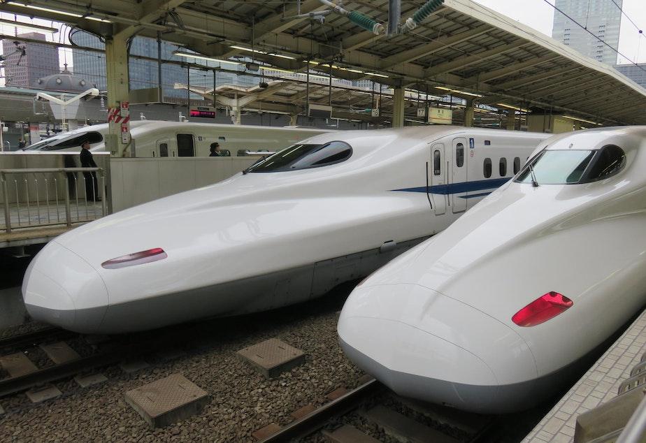 caption: Shinkansen bullet trains, seen here in Tokyo.