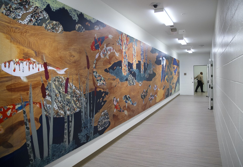 caption: A mural by Haruka Ostley called 'Journey to Peace' spans a hallway on Wednesday, February 5, 2020, during a media tour of the new Clark Children and Family Justice Center on Alder Street in Seattle.