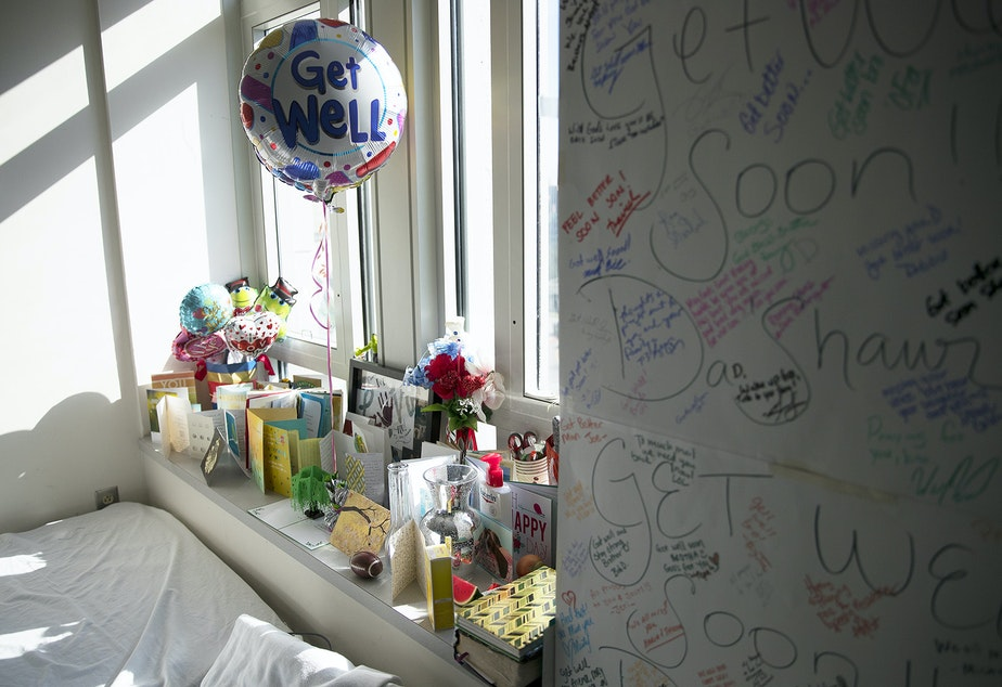"Cards and flowers fill a windowsill next to the small cot where LaDonna Horne slept on Thursday, March 15, 2018, in DaShawn Horne's room at Harborview Medical Center in Seattle. ""The outpour was just pure love,"" LaDonna said. ""Strangers from all over. I didn't know any of these people, but we're friends now."""