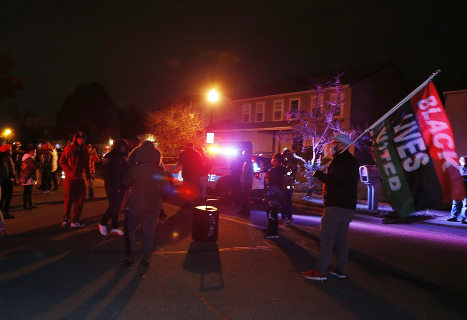 caption: A crowd gathers to protest in the neighborhood where a police officer fatally shot a teenage girl on Tuesday in Columbus, Ohio.