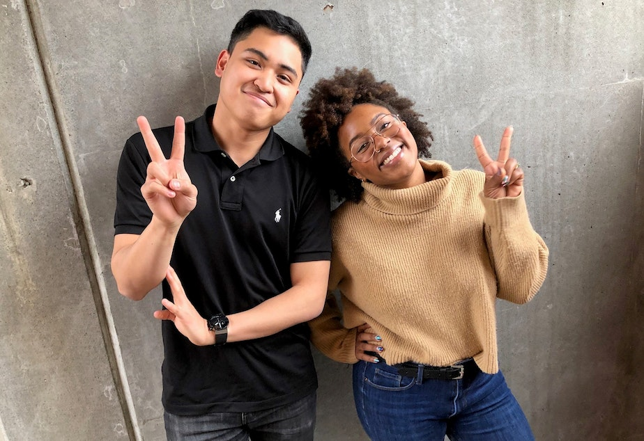 caption: Joe Santiago and Ishea Brown of KUOW's Curiosity Club pose for a photo after recording a follow-up conversation at KUOW Public Radio in Seattle. March 25, 2019.