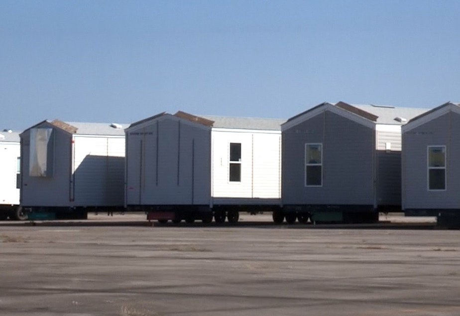 caption: FEMA disaster relief trailers in storage.