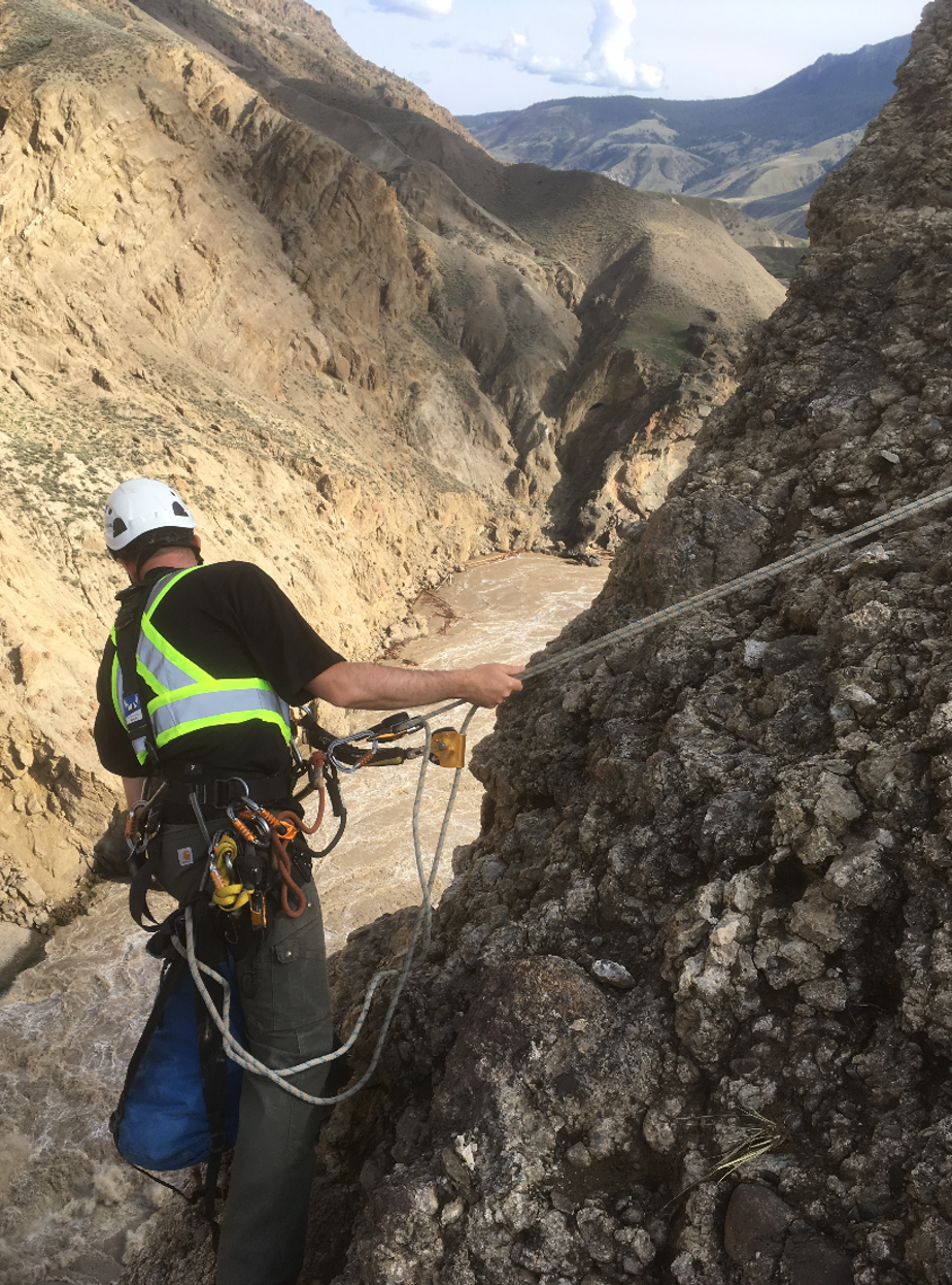 A geologist examines the rockslide site above Canada's Fraser River.
