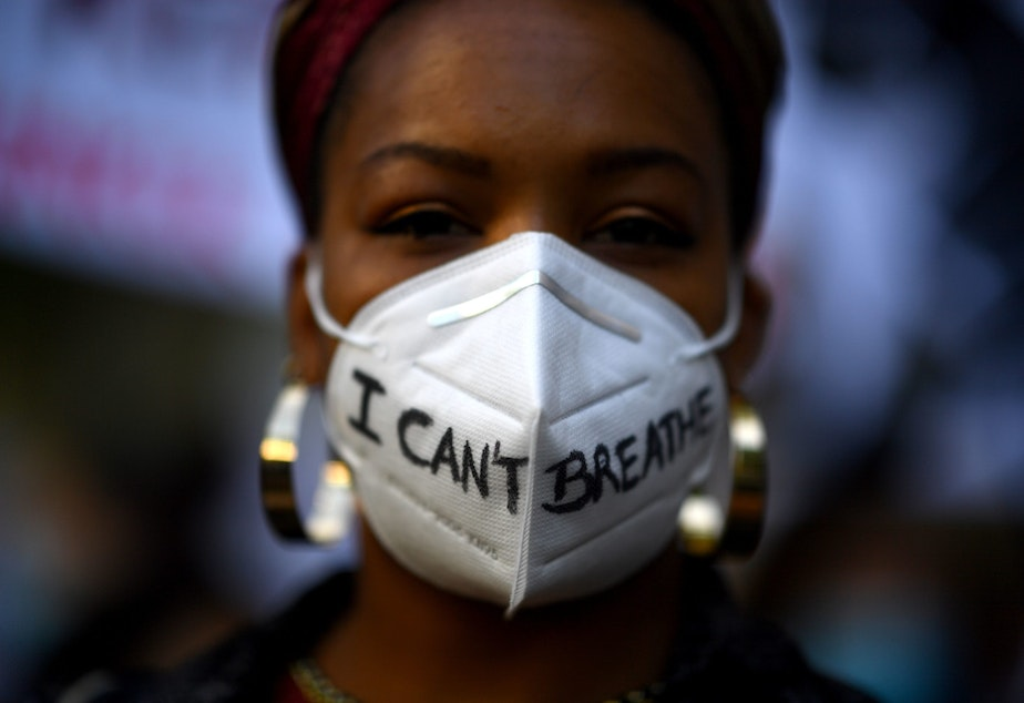 "caption: A woman wears a mask reading ""I can't breathe"" in Madrid, on June 7, 2020, during a demonstration against racism and in solidarity with the Black Lives Matter movement, in the wake of the killing of George Floyd. (GABRIEL BOUYS/AFP via Getty Images)"