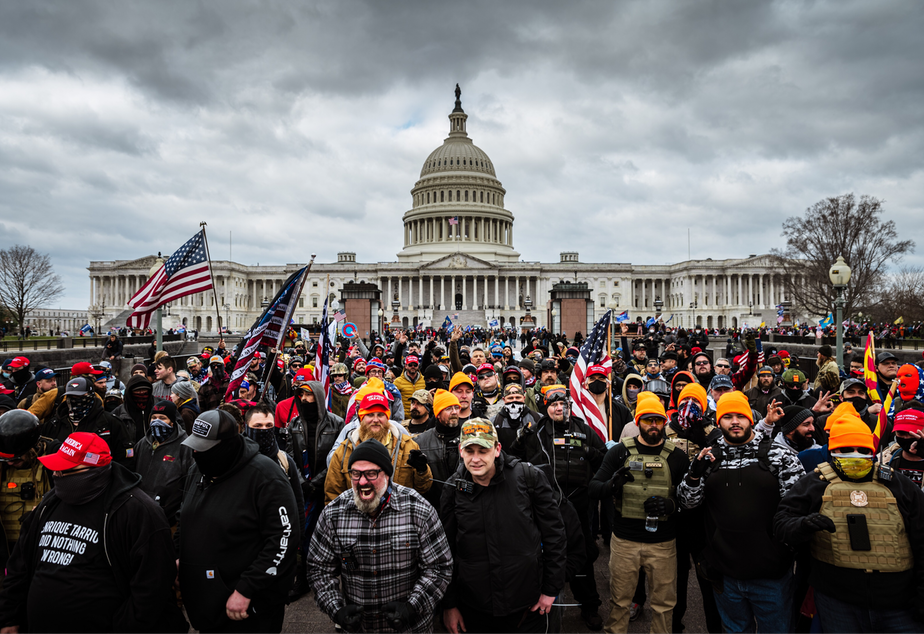 caption: Pro-Trump protesters gather in front of the U.S. Capitol Building on Jan. 6, 2021 in Washington, D,C. (Jon Cherry/Getty Images)