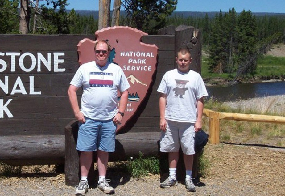 caption: Jim Hamre (left) and Zack Willhoite are shown in a photo taken at Yellowstone National Park in 2005.