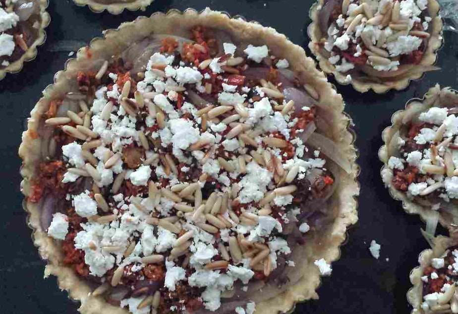 """Brenda Abdelall's goat cheese and onion tart is a yearly Thanksgiving staple, and draws on flavors from her Egyptian heritage. She calls it her version of """"American pie."""""""