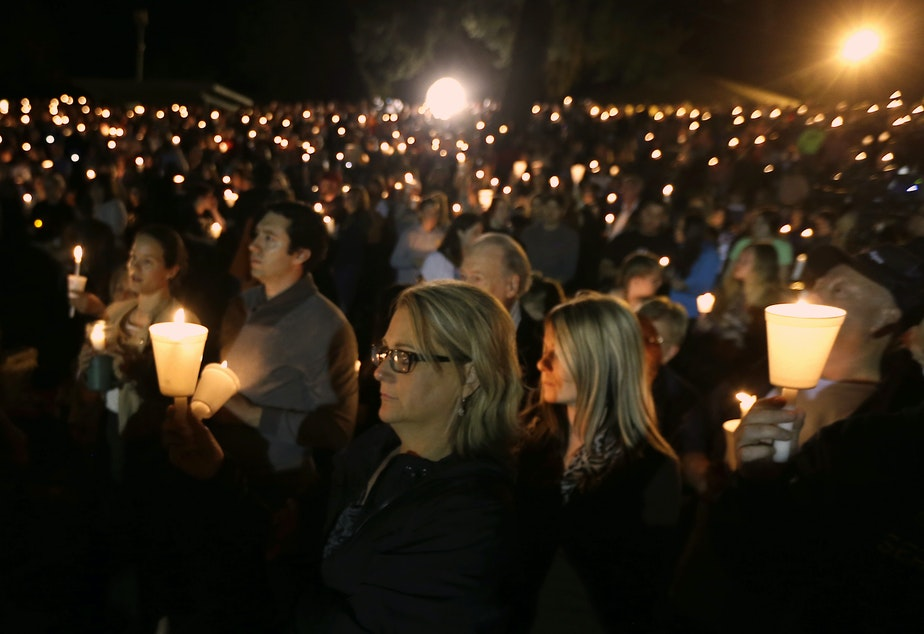 Community members gather for a candlelight vigil for those killed in a shooting at Umpqua Community College in Roseburg, Ore., Thursday, Oct. 1, 2015.