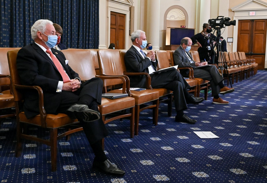 caption: Members of congress practice social distancing as the House Rules Committee meets to consider a resolution authorizing remote voting by proxy in the House of Representatives during a public health emergency due to the coronavirus outbreak, and to formulate a rule on the newest coronavirus relief bill on Capitol Hill on Thursday.