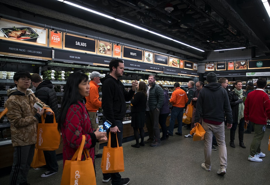 Customers shop at Amazon Go on Monday, January 22, 2018, on 7th Ave., in Seattle.