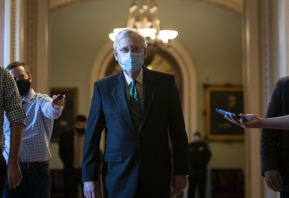 caption: Senate Majority Leader Mitch McConnell walks back to his office after delivering opening remarks at the U.S Capitol on Wednesday.
