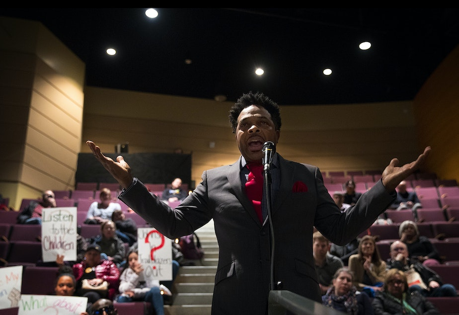 caption: Kevin Amos addresses Seattle Public Schools leadership about teacher misconduct issues during a public meeting on Thursday, February 13, 2020 at Garfield High School in Seattle.