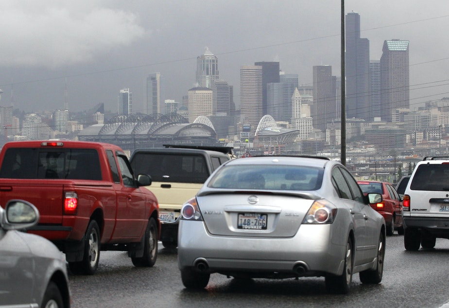 caption: The Seattle skyline behind heavy traffic on northbound Interstate 5 in 2011.