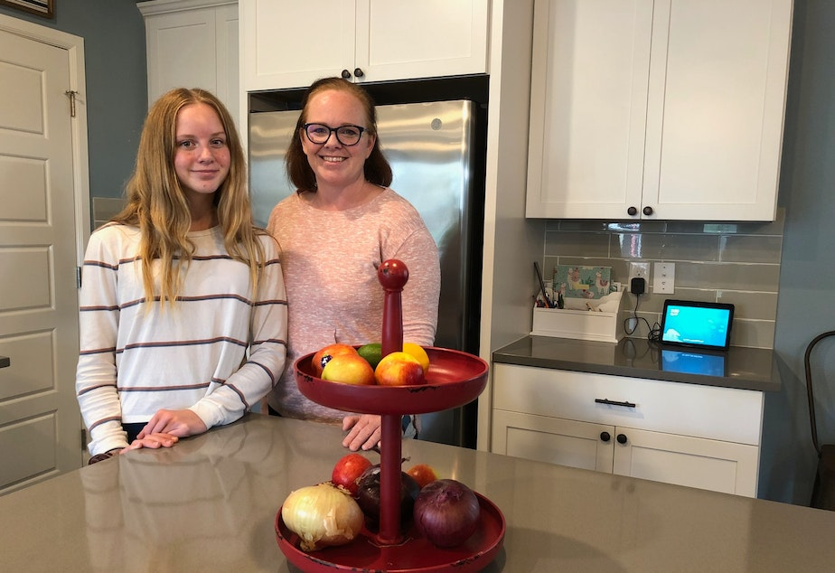 caption: Macy (L) and Kelli (R) Ferguson live in an Amazon smart home in Black Diamond, Washington.