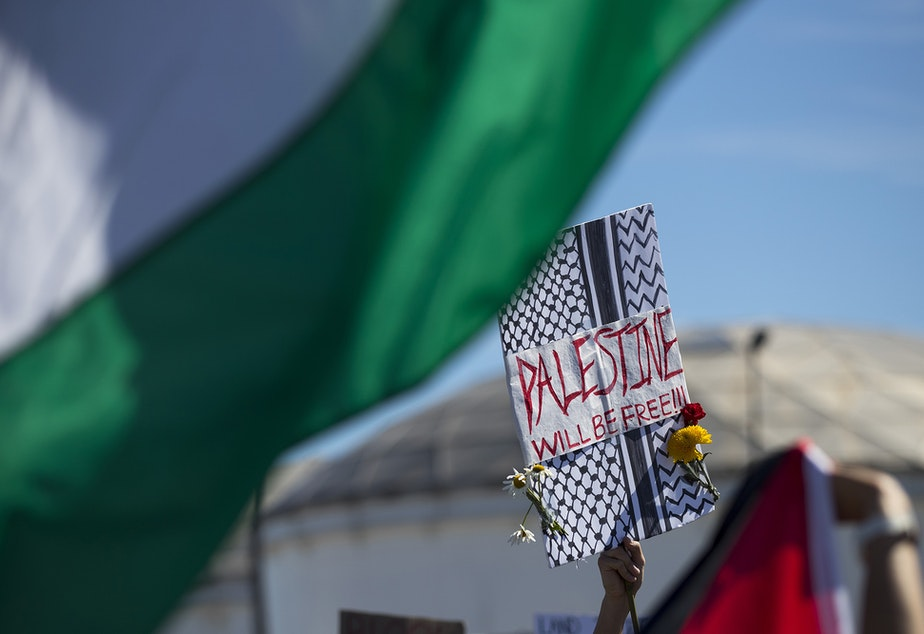 """caption: Activists and allies of the Palestinian feminist organization Falastiniyat block an intersection in protest of the Israeli Zim San Diego Vessel, on Thursday, June 17, 2021, at the Port of Seattle. """"We are now calling on our city officials to stand behind their communities against Israeli human rights abuses, and not to give into the bullying of the apartheid state of Israel,"""" said Aisha Mansour, a representative of Falastiniyat."""