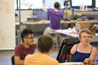 Kayla Wheeler, right, visits the University of Washington's CoMotion MakerSpace.