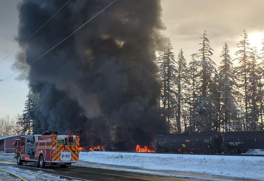 caption: Bakken crude oil fire sends up black smoke from a derailed train in Custer, Washington, on Dec. 22, 2020.