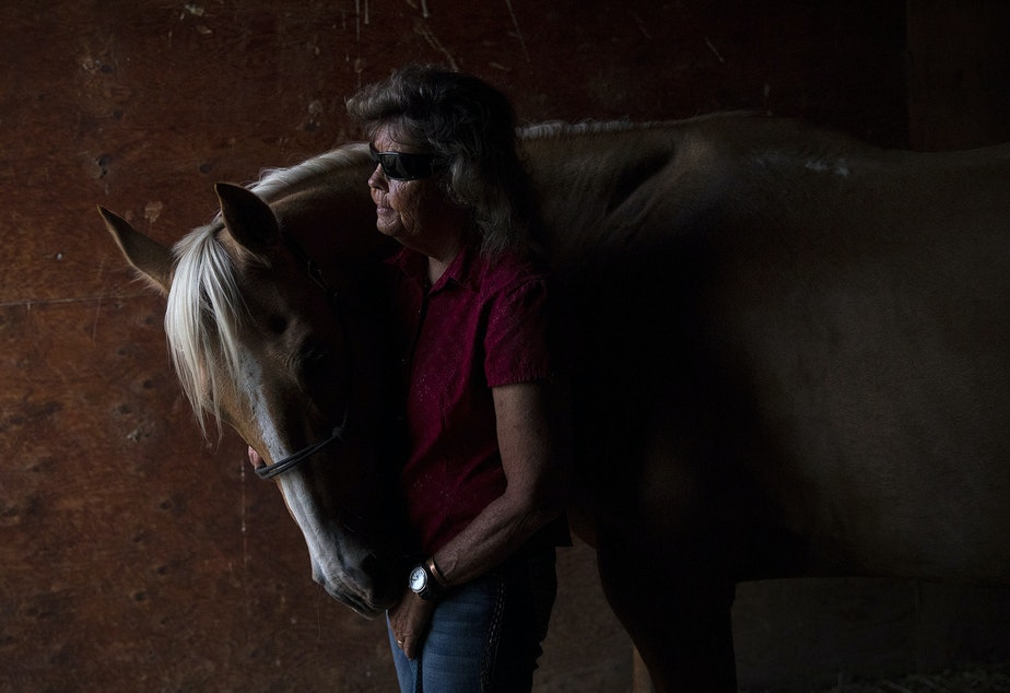 caption: Julie Hensley poses for a portrait with her horse, Hot Rod, in her barn on Tuesday, July 16, 2019, in Brewster. Julie lost her sight in her early twenties when the horse that she was riding fell, causing her retinas to detach.