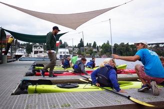 These Paddlers at the Agua Verde Paddle Club on Portage Bay were among the first on the water when the club reopened on Thursday