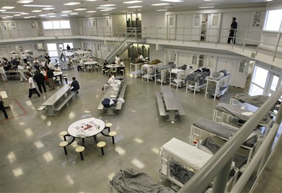 caption: A file picture from Oct. 17, 2008, shows the 'B' cell and bunk unit of the Northwest Detention Center in Tacoma, Wash.