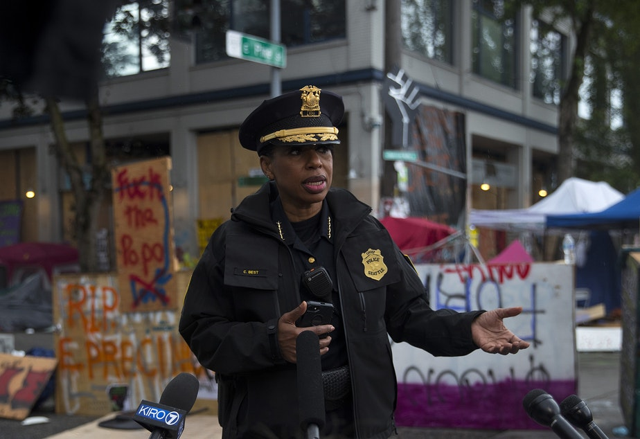 caption: Seattle Police Chief Carmen Best holds a press briefing after the Capitol Hill Organized Protest zone was cleared by Seattle Police Department officers early Wednesday morning, July 1, 2020, at the intersection of 12th Avenue and East Pine Street in Seattle.