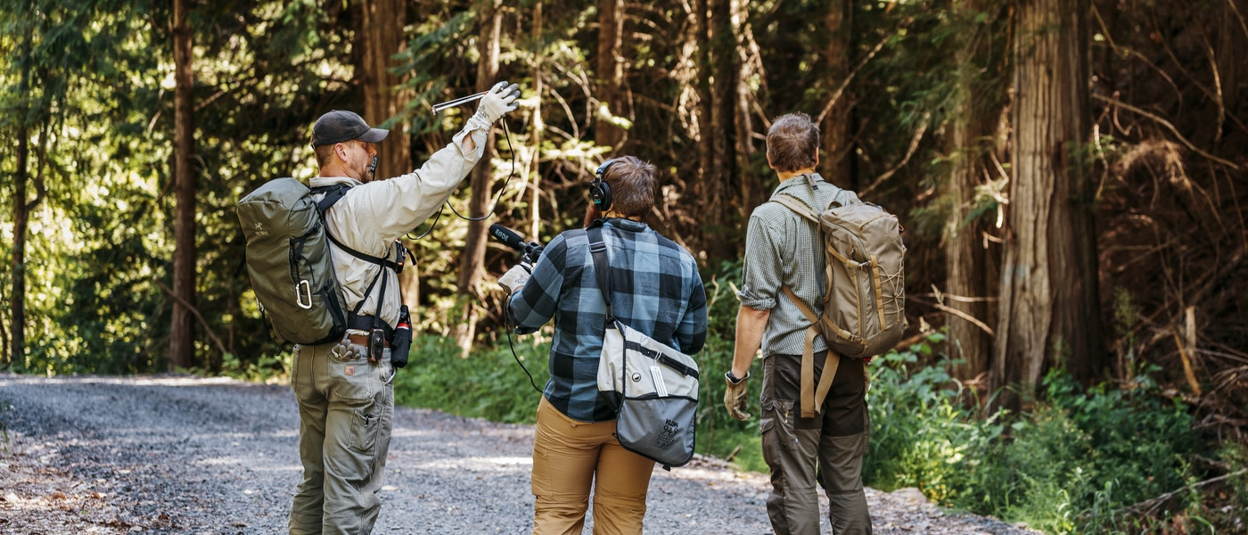 caption: Research scientist Brian Kertson, 'The Wild' producer Matt Martin and host Chris Morgan tracking a cougar in Washington state.