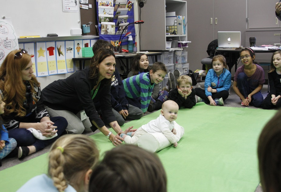 """Roots of Empathy instructor Rebecca Young and """"teacher"""" baby Declan give a lesson at Highland Terrace Elementary School in Shoreline."""