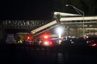The scene of an Amtrak derailment over Interstate 5 taken in the evening on Monday, December 18, 2017 from Mounts Road.