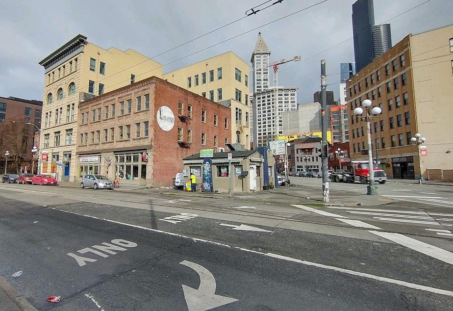 caption: The tiny Main Street Gyros against the Seattle skyline