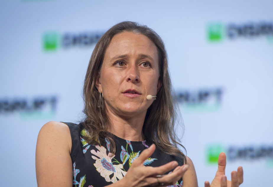 Anne Wojcicki, chief executive officer and co-founder of 23andMe, speaks during the TechCrunch Disrupt 2018 summit in San Francisco in September 2018.