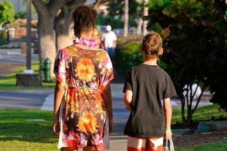 A family photo of Adina and her son Ruben walk back from a day at the pool. Now Ruben is a teenager and has been experimenting with drugs.