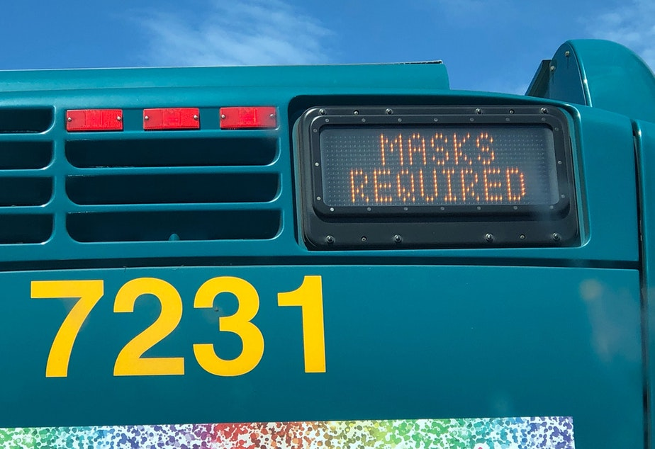 caption: A King County Metro bus in Seattle, Aug. 2, 2020, with a message that masks are required on the bus.